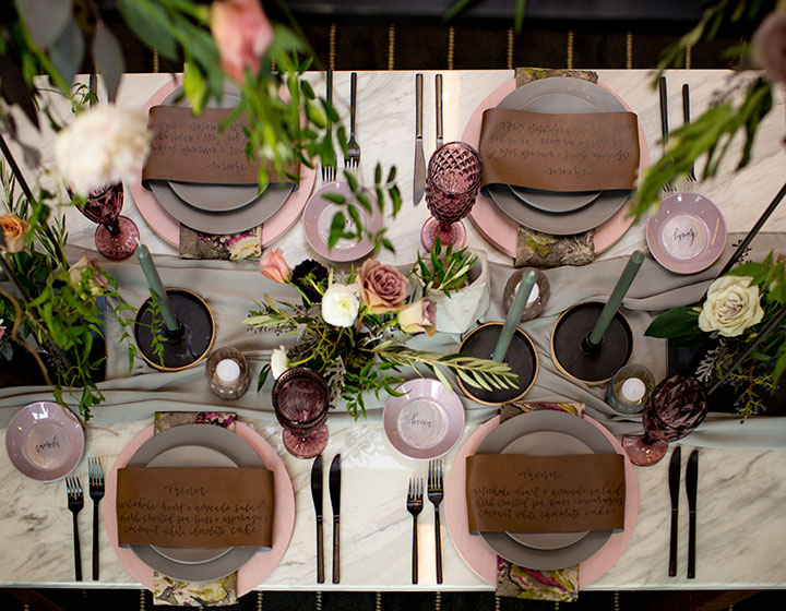 wedding tablescape with greenery and place settings