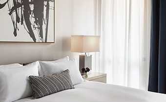 The Kimpton Pittman Hotel bed and sidetable